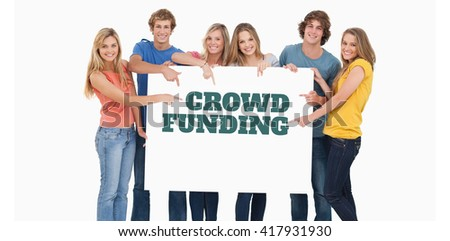 Smiling group of people with a blank space as they point to it against the word crowdfunding against white background - stock photo