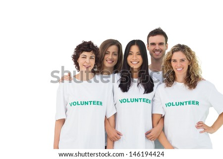 Smiling group of volunteers standing on white background - stock photo