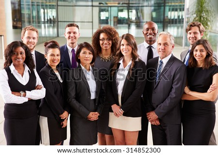 Smiling group portrait of corporate business colleagues - stock photo