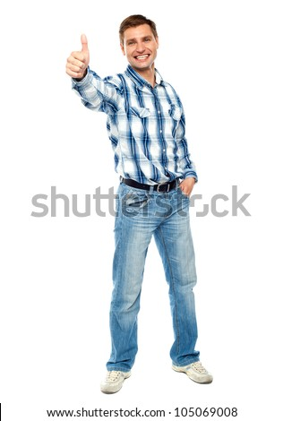 Smiling guy gesturing thumbs up isolated over white background - stock photo