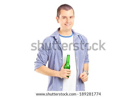 Smiling guy holding a beer bottle isolated on white background - stock photo