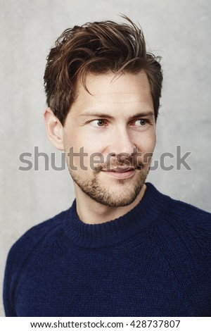 Smiling guy in blue sweater