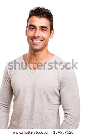 Smiling guy posing over white background - stock photo