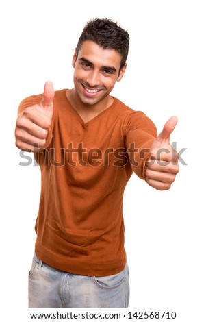 Smiling guy showing thumbs UP