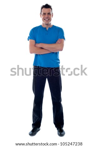 Smiling guy with crossed arms looking at camera - stock photo
