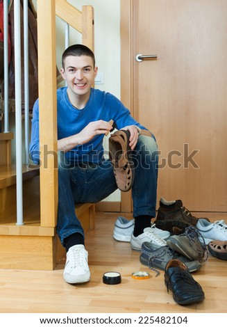 Smiling guy  with shoes at home