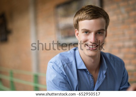 Smiling Handsome Blond Young Man in Pub