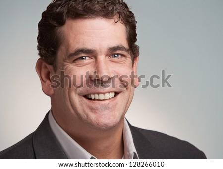 Smiling handsome friendly man closeup portrait - stock photo