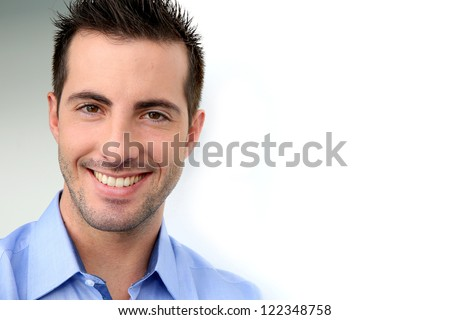 Smiling handsome guy leaning on white background - stock photo