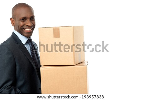 Smiling handsome male carrying cardboard box - stock photo