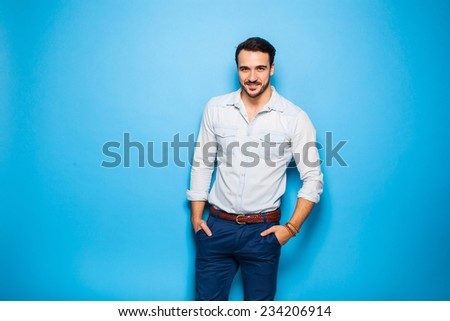 smiling handsome man on a blue background - stock photo