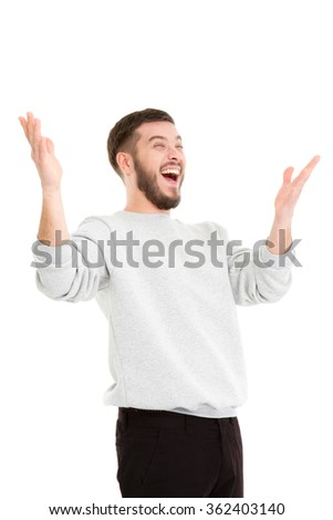 Smiling handsome man over white background. Hands up. isolated