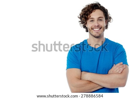 Smiling handsome man posing with folded arms - stock photo