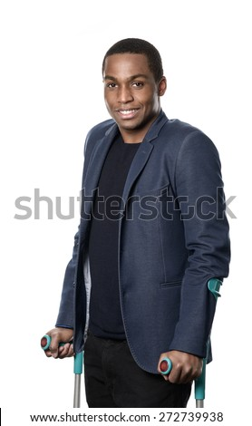 Smiling handsome young African man walking on forearm crutches isolated on white conceptual of a disability and healthcare, three-quarter pose - stock photo