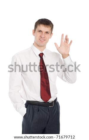Smiling handsome young businessman with a welcoming gesture. - stock photo