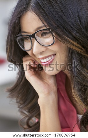 Smiling happy beautiful young Asian Chinese woman or girl wearing geek glasses  - stock photo