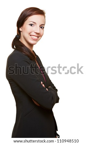 Smiling happy businesswoman with her arms crossed - stock photo