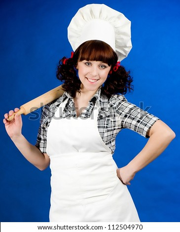 Smiling happy cook woman  on a blue background - stock photo
