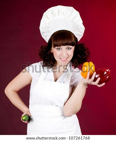 Smiling happy cook woman with vegetables - stock photo