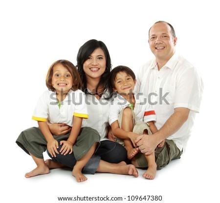 smiling happy family isolated on white background - stock photo