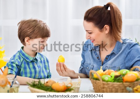 Smiling happy family on easter time - stock photo