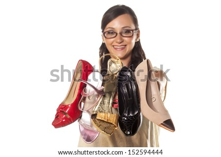 smiling happy girl holding in her hand a bunch of high-heeled shoes - stock photo