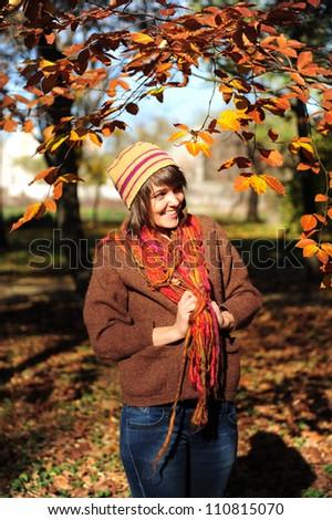 Smiling happy girl in autumn park. - stock photo