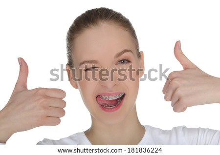 Smiling happy girl with braces on teeth  isolated on white - stock photo