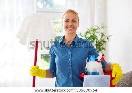 Smiling happy housewife ready for cleaning home - stock photo