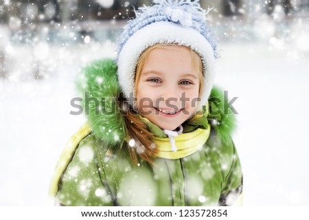 Smiling Happy little girl in winter vacation - stock photo