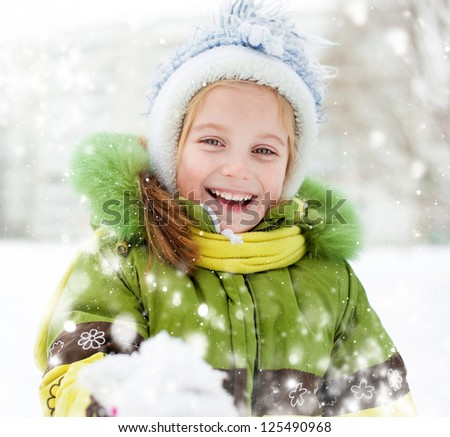 Smiling Happy little girl winter vacation - stock photo