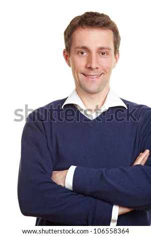 Smiling happy man standing with his arms crossed - stock photo