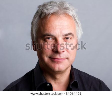 Smiling, happy older man, isolated headshot - stock photo