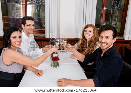 smiling happy people friends in restaurant for dinner