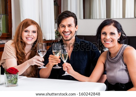 smiling happy people in restaurant drinking talking having fun  - stock photo