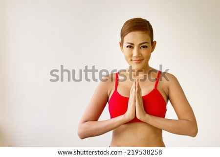 smiling, happy, positive fitness woman practicing yoga meditation - stock photo