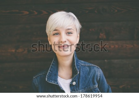 smiling happy real blond young woman