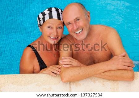 smiling happy seniors relaxing travel team - stock photo