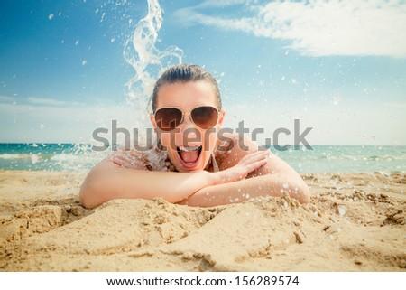 smiling happy summer splash on coast - stock photo