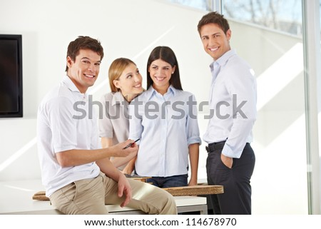 Smiling happy team of business architects in their office - stock photo