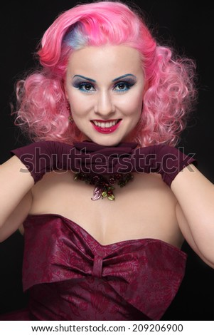 Smiling happy vintage beauty with pink curly hair and fancy make-up - stock photo