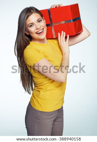 Smiling happy woman hold big red gift box. Isolated portrait. Long hair. - stock photo