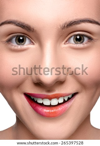 Smiling happy woman with colorful lips make up looking at the camera. Close up head shot