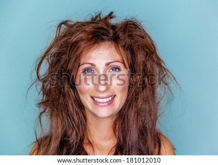 smiling happy woman with crazy hair - stock photo