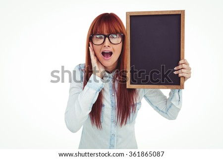 Smiling hipster woman holding blackboard against white background