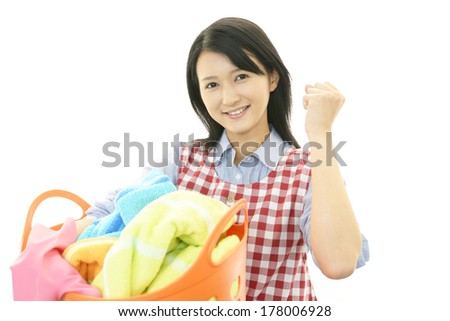 Smiling housewife - stock photo