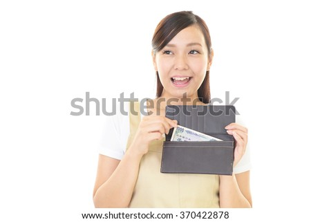 Smiling housewife with a wallet