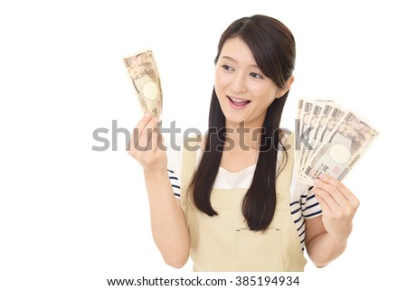 Smiling housewife with money