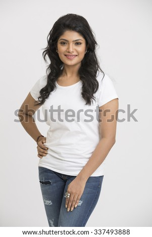 Smiling Indian pretty woman posing on white background. - stock photo