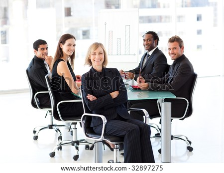 Smiling international business people sitting in a presentation